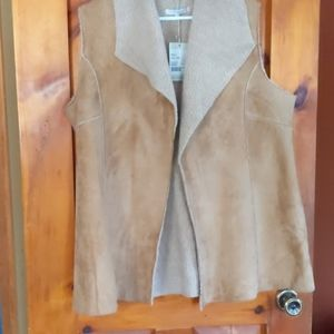 Ladies faux suede sherpa lined fold neck vest.